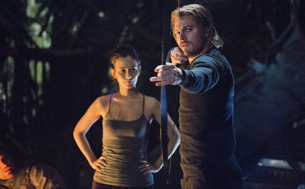 Celina Jade as Shado and Stephen Amell as Oliver Queen in Arrow S01E09: 'Unfinished Business'