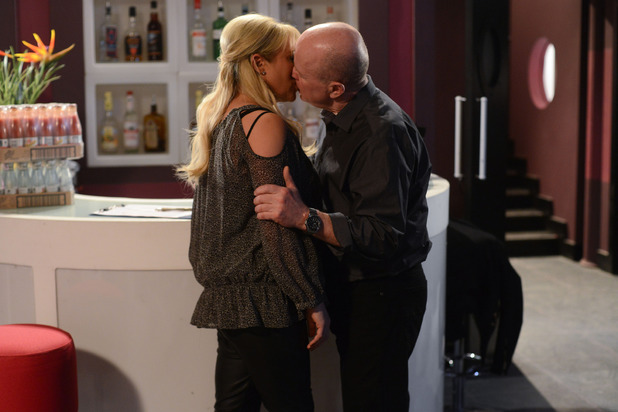 Phil tenderly kisses Sharon