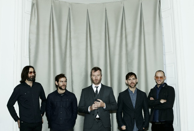 Matt Berninger, Aaron Dessner, Bryce Dessner, Bryan Devendorf and Scott Devendorf of The National pose for 2013 album Trouble Will Find Me.