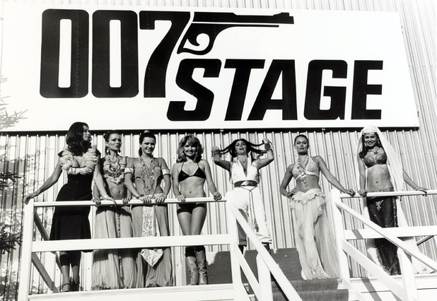 Bond girls assemble by the 007 Stage at Pinewood Studios.