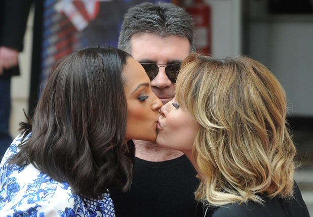 Alesha Dixon and Amanda Holden kiss in front of Simon Cowell at the press launch for the new series of 'Britain's Got Talent' on 11 April 2013