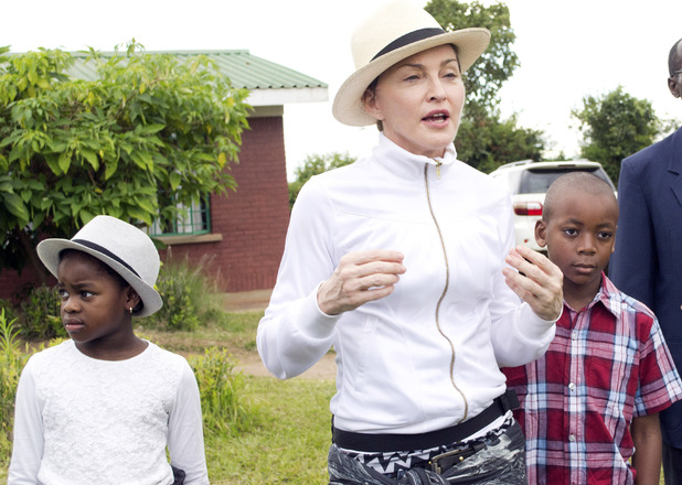 Madonna with her children Mercy James and David Banda in Malawi ~~ April 5, 2013