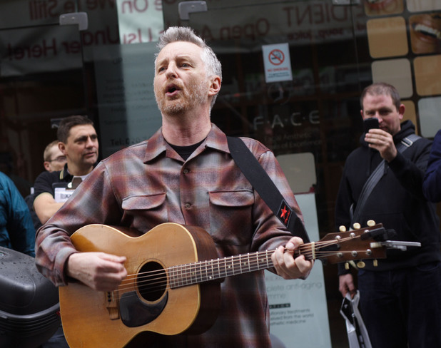 Billy Bragg performs outside Sister Ray Records in Soho, London on Record Store Day 2012