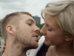 Calvin Harris and Ellie Goulding kiss in 'I Need Your Love' music video.