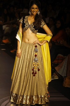Ileana D'Cruz displays a creation by Vikram Phadnis during the Lakme Fashion Week in Mumbai, March 2013.