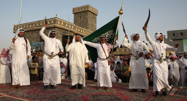 Saudi men perform the traditional Arda dance during the Janadriyah Festival of Heritage and Culture on the outskirts of the Saudi capital Riyadh