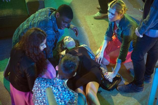 Maxine falls unconscious.