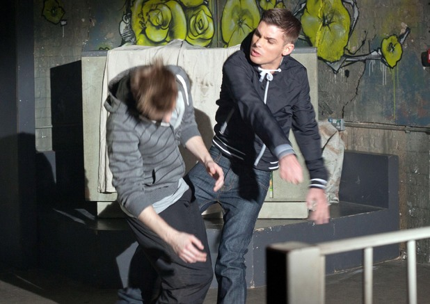 Ste punches Kevin.
