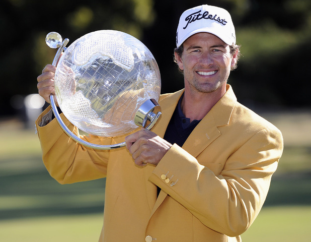 Adam Scott from Australia poses with the trophy for photographers after winning the Australian Masters golf tournament at Kingston Heath Golf Club in Melbourne, on November 18, 2012