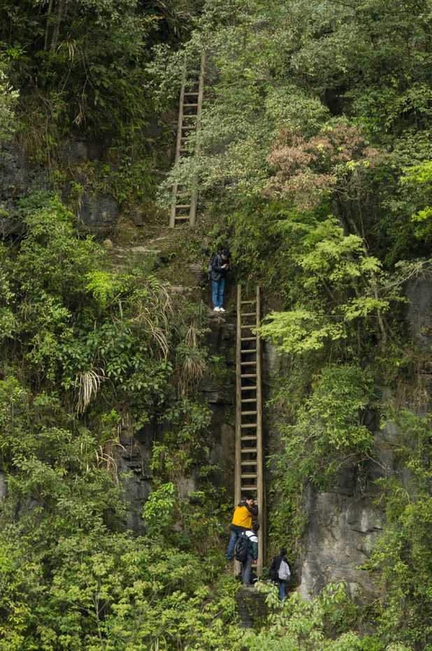 Children climb cliffs to get to school