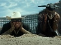Armie Hammer's masked hero and Depp's Tonto bring down a train in new promo.