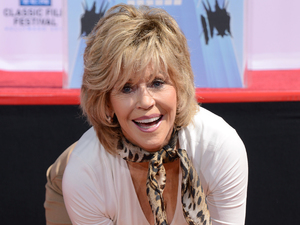 Jane Fonda gives an impression of her hands at her hand and footprint ceremony.