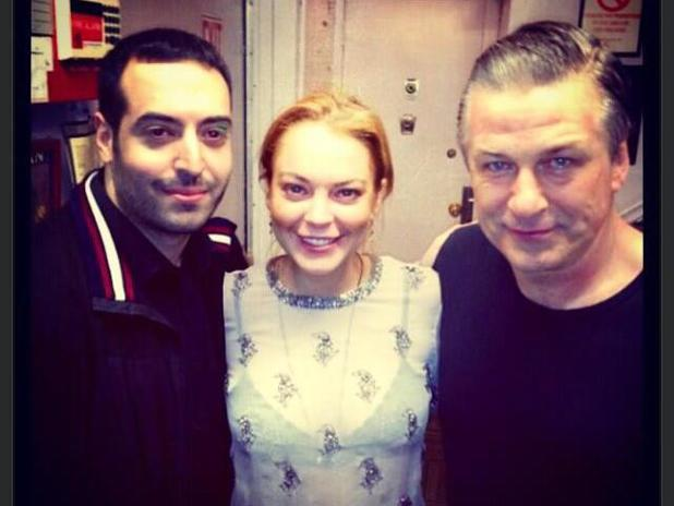 Lindsay Lohan poses with Mohammed Al Turki and Alec Baldwin backstage at the Broadway play 'Orphans'
