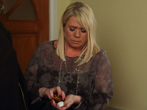 Sharon takes her pills.