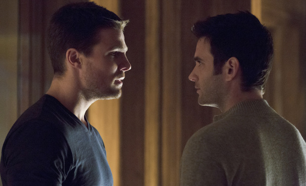 Stephen Amell as Oliver Queen and Colin Donnell as Tommy Merlyn in Arrow S01E20: 'Home Invasion'