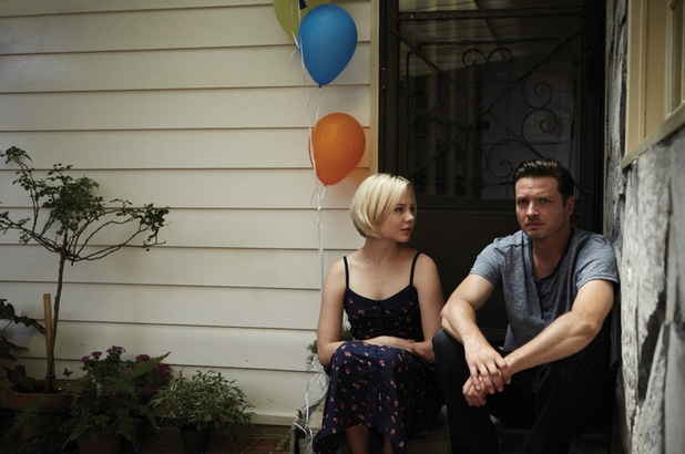 'Rectify' still: Tawney Talbot (Adelaide Clemens) and Daniel Holden (Aden Young) with balloons on porch