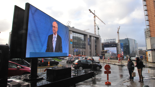EU Council president Herman Van Rompuy appears on a giant screen