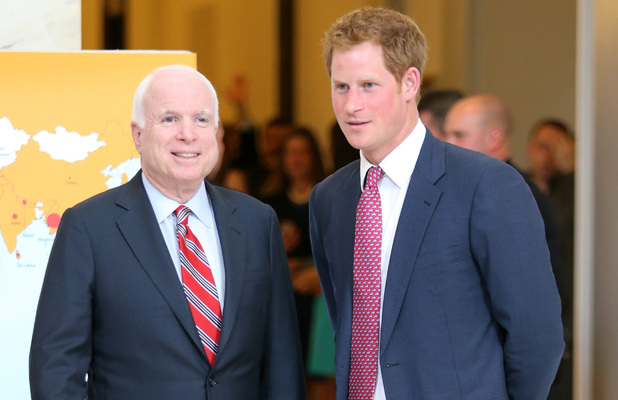 Senator John McCain and Prince Harry tour an anti-landmine photography exhibition by The HALO Trust charity
