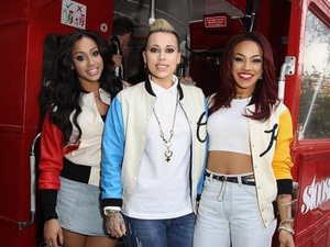 Stooshe perform on double-decker bus