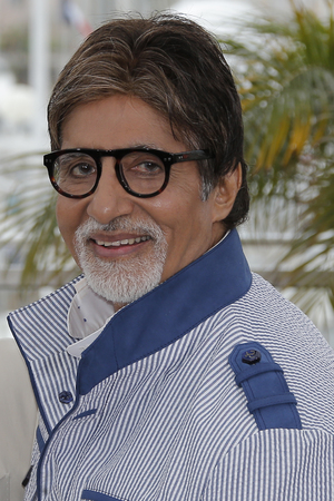 Actor Amitabh Bachchan poses for photographers during a photo call for the film The Great Gatsby at the 66th international film festival, in Cannes, southern France, Wednesday, May 15, 2013.
