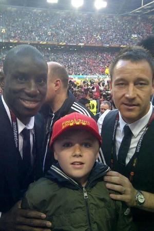 Louis Kearns poses with Demba Ba & John Terry