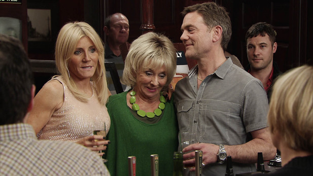 Karl is at Stella's side at the reopening of the Rovers Return on Coronation Street