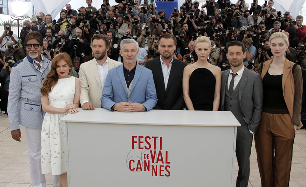 Amitabh Bachchan, Isla Fisher, Joel Edgerton, Director Baz Luhrmann, Actors Leonardo Di Caprio, Carey Mulligan, Tobey Maguire and Elizabeth Debicki pose for photographers during a photo call for The Great Gatsby at the 66th international film festival, in Cannes, southern France, Wednesday, May 15, 2013.