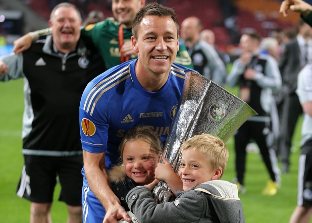 John Terry celebrates with the UEFA Europa League trophy in full kit after the game despite not playing due to injury
