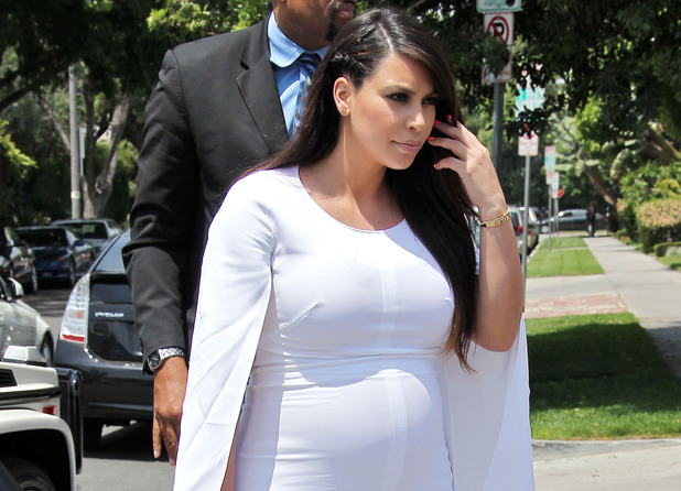 Kim Kardashian, tight shoes, pregnancy, Givenchy white cape dress, Givenchy perspex heels Albertina Podium shoes