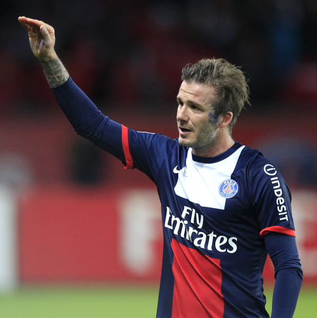 David Beckham waves as he leaves the field, during his French League One soccer match against Brest.