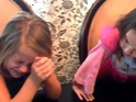 Girls react to new of twins from cake