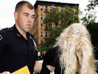 Amanda Bynes arrives at court cuffed and hiding behind a wig.