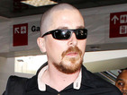 Dark Knight Rises actor debuts his bald head and ginger goatee.