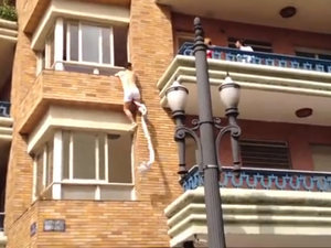 Half-naked Brazilian climbs out of lover's window