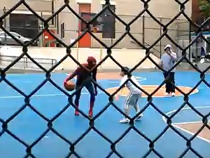 'Amazing Spider-Man' Andrew Garfield plays basketball with children