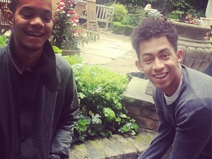 Rizzle Kicks poses in front of Abbey Road sign.