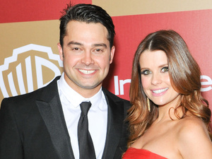 Nick Swisher and JoAnna Garcia at the InStyle and Warner Bros. Golden Globe after party in January 2013