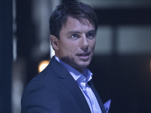 John Barrowman as Malcolm Merlyn in Arrow S01E23: 'Sacrifice'