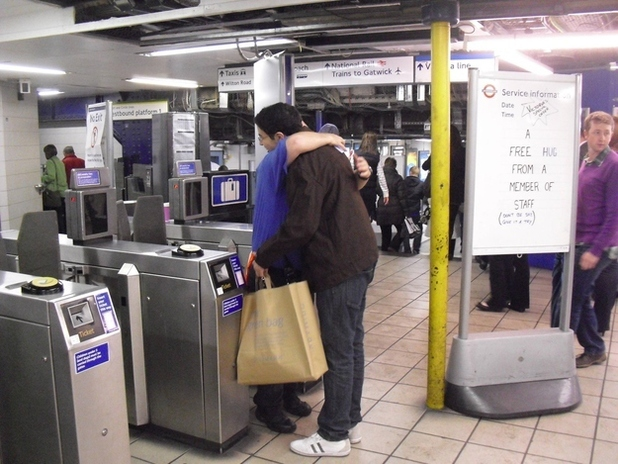 Victoria tube station giving free hugs