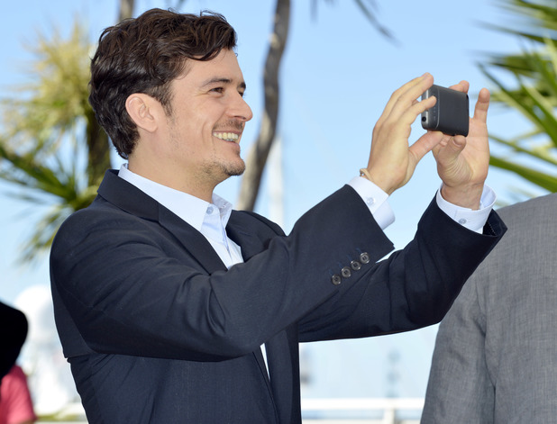 Orlando Bloom has some fun at the 'Zulu' photocall.