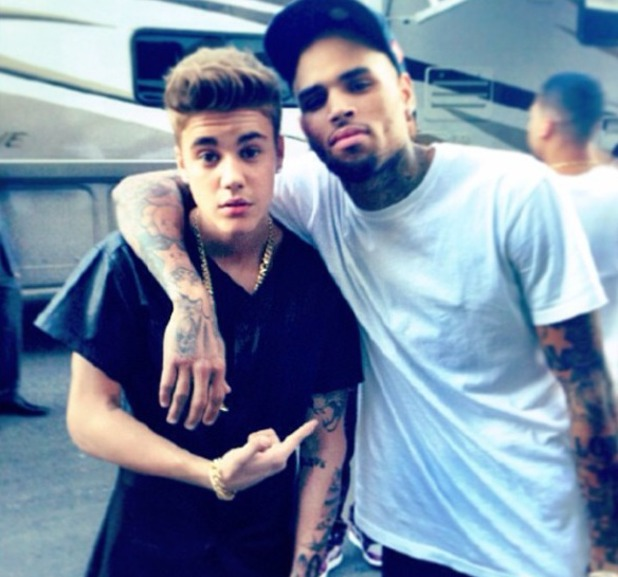 Justin Bieber poses with Chris Brown