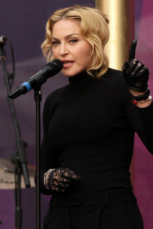 Madonna performing at the Chime for Change Live concert held at Twickenham Stadium, London.