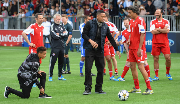 Will and Jaden Smith prepare to take a penalties during UEFA's Champions Festival