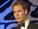 Handsome Prince Harry looking dapper in a tuxedo at charity ball.