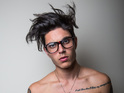 Glee star Samuel Larsen loses dreadlocks and clothes for photoshoot.