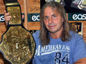 WWE Hall of Fame wrestler Bret 'The Hitman' Hart signs copies of his book 'Bret Hart Hitman' at Easons