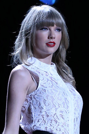 Taylor Swift performs at the CMA Music Festival.