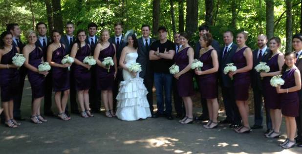 John Travolta poses with a wedding party