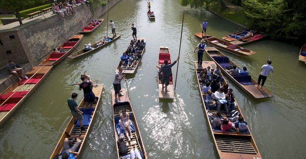 Punting on the River Cam by Trinity Hall, Cambridge, Britain