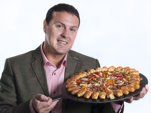 Paddy McGuinness with a Pizza Hut pizza